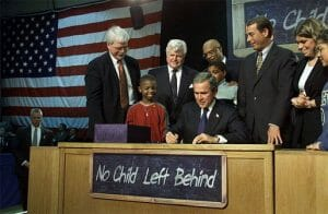 George W. Bush signs No Child Left Behind into law