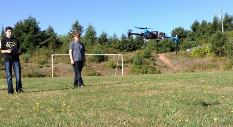 students fly drones