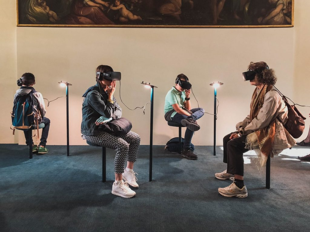 a group of students wearing VR headsets