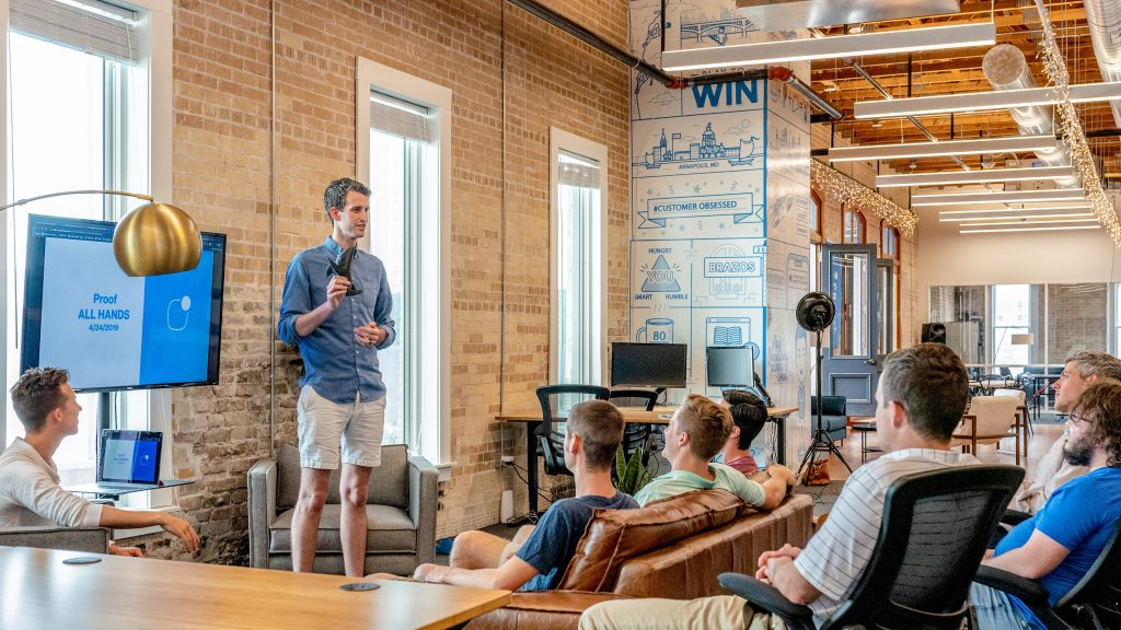 Millennial workplace learning occurs in a modern, loft-style office.