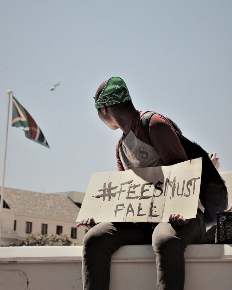 A protester demonstrates during the #FeesMustFall protest.