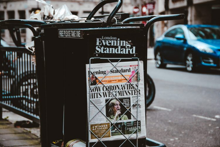 An image of the U.K.'s Evening Standard paper stand bearing a headline about coronavirus.