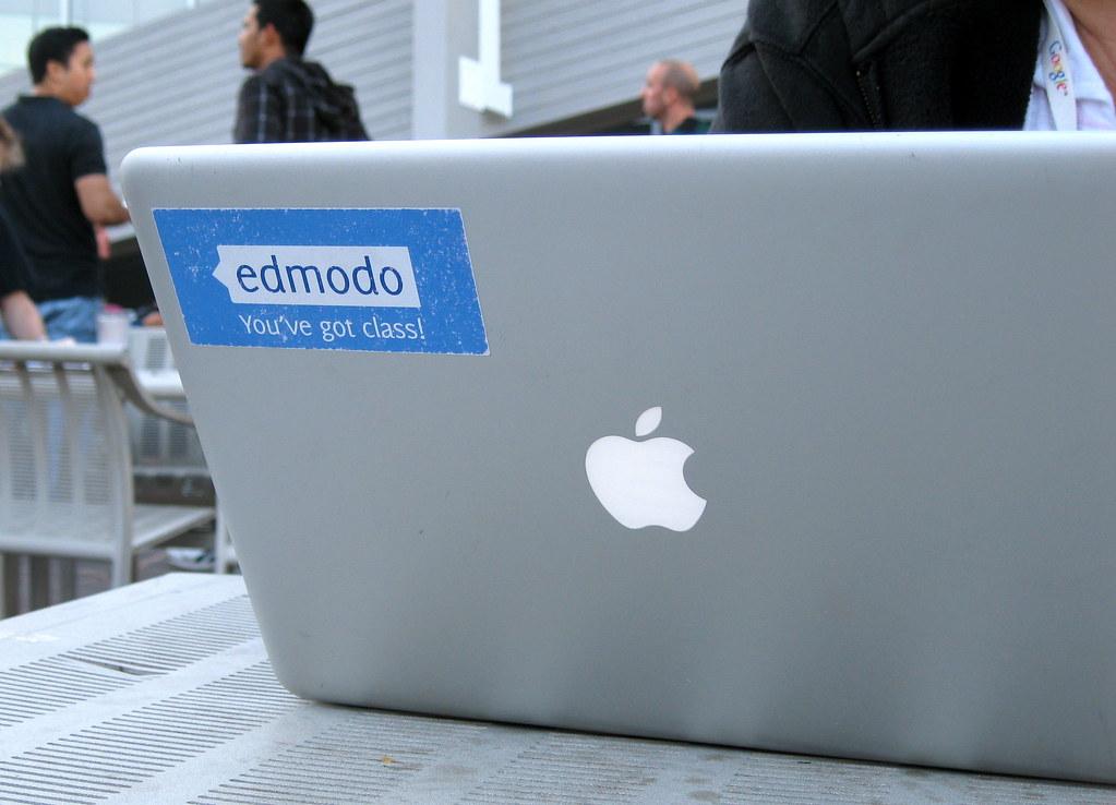 """An Apple laptop bears an Edmodo sticker which reads """"You've got class."""""""