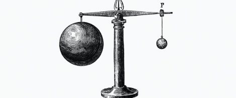 An illustration of two balls of different volumes but similar masses balance on a scale.