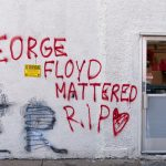 "Graffiti on a wall reads ""George Floyd Mattered R.I.P."""