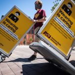 ASU workers roll out ppe and signage on campus