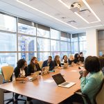 A team meets in a conference room