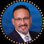 Dr. Miguel Cardona headshot