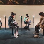 Museum goers access a VR installation.